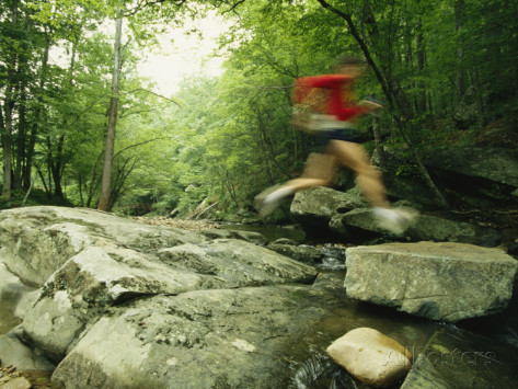 skip-brown-panned-view-of-man-leaping-over-rocky-stream-on-the-appalachian-trail